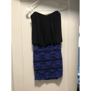 Women's short, strapless, stretchy lace dress.